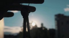 Slowmotion close up of hand palm holding door keys outside in bright sun Stock Footage
