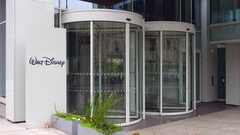 Street signage board with Walt Disney logo. Modern office building. Editorial 4K Arkistovideo