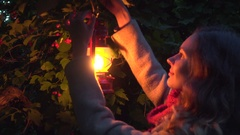 Girl hang with lantern in dark autumn forest Stock Footage