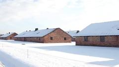 Steadicam shot of Auschwitz Birkenau barracks in winter. German Nazi Stock Footage