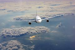 Airplane fly over clouds. Transportation travel concept Stock Photos