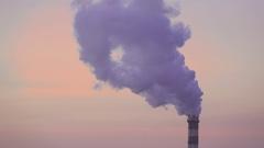Smoking chimneys CHP at sunset Stock Footage