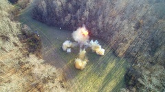 Aerial view of cool large explosion in open field Stock Footage