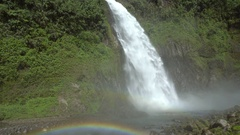 Cascada Magica (Magic Waterfall) with double rainbow and mist blowing towards ca Stock Footage