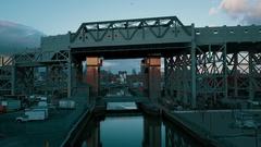 Dusk flying under bridge revealing Gowanus Canal Stock Footage