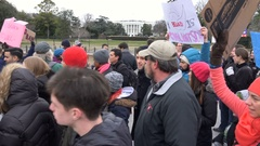 "Protesters pass White House, ""We will not go away, Welcome to Your Every Day!"" Stock Footage"