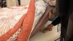 Money under mattress hide woman Stock Footage
