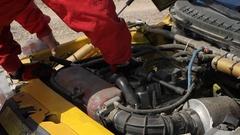 Mechanic repairing motor during sports racing Stock Footage