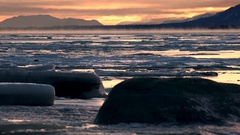 Frozen Expanse of Ice and Stone Misty Sunset Scenic in Alaska Stock Footage