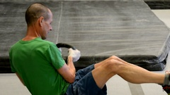 Older athlete straining through core workout with kettlebell, tight. Stock Footage