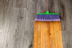 Sweeping out wooden parquet Stock Photos