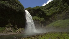 Cascada Magica (Magic Waterfall) with  mist blowing towards ca Stock Footage