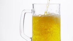 Light Beer is Poured into a Beer Mug Stock Footage