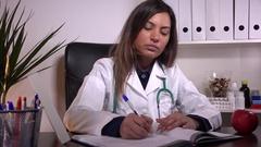 Ill woman doctor sneezing sick person sneeze medic having flu writing treatment Stock Footage