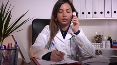 Telephone discussion doctor patient medical office phone consultation advising  Stock Footage