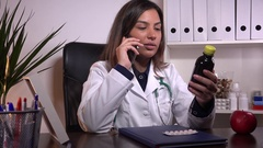 Female doctor discussing patient on cell phone pills treatment communication 4K  Stock Footage