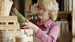 Elderly Businesswoman Inspecting Squash Stock Footage