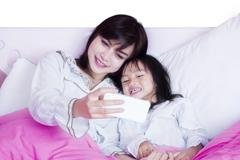 Beautiful mother and child take selfie photo Stock Photos
