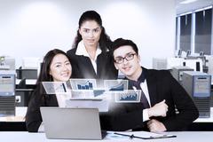 Multiracial business team looks success Stock Photos