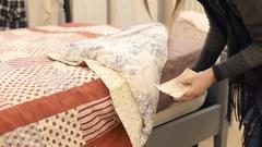 Money under mattress pick count woman Stock Footage