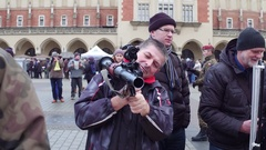 KRAKOW, POLAND - Man examines grenade launcher at military Stock Footage