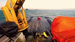 Tug Boat establishes platform lift anchor Stock Footage