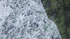 Waves break over the rocky coastline of the southern coast of the Mornington Pen Stock Footage