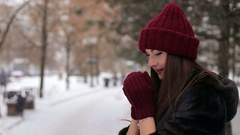 Portrait of beautiful happy girl, wearing stylish knitted winter hat and gloves. Stock Footage