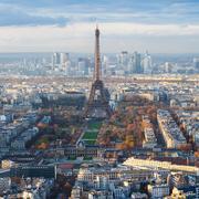 Paris skyline with Eiffel Tower over Champ de Mars Stock Photos