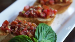 Antipasto Bruschetta, baguette slices topped with tomatoes basil mixed sauce Stock Footage