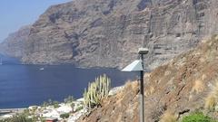 View of coast, Atlantic ocean and los gigantes rocks, in Tenerife, Spain Stock Footage