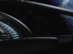 7549 Alien Space Ship Drawing near to a Blue Planet Close up Stock Footage