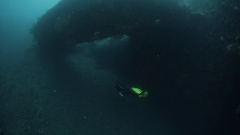 Free diver exploring the ship wreck Stock Footage
