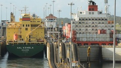 Panama canal,  a cargo ship entering the miraflores locks in the panama Stock Footage