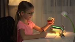 4K Internet Usage on Tablet, Child Writing, Girl Studying for School, Night View Stock Footage