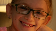 4K Laughing Eyeglasses Child Portrait Looking at Camera, Happy Girl Face Smiling Stock Footage