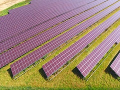 Aerial view to solar power plant in fields. Stock Footage