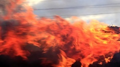 Big flame of a fire at the dump Stock Footage