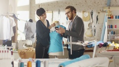 Male and Female Fashion Designers are Working on Tailored Mannequin  Stock Footage