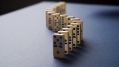 White Dominoes Falling in Chain Reaction. Domino Effect Stock Footage