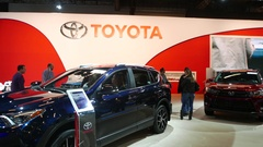 4K Toyota Cars on Display at Auto Show   Customers Shopping Stock Footage