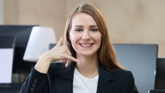 Call Us, Contact Us, Gesture by Woman in Office Stock Footage