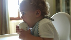 Adorable cute toddler baby putting feet on his mouth Stock Footage
