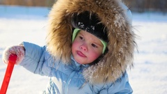 Happy child with fun laughing in winter park on a sunny day. snow winter Stock Footage