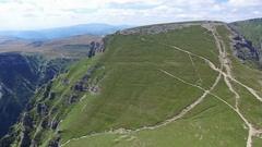 Caraiman Peak, flight towards hikers on mountain trail, Romania Stock Footage
