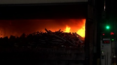 Aluminium foundry furnace load with metal red hot flames glowing liquid melting Stock Footage