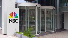 Street signage board with National Broadcasting Company NBC logo. Modern office Stock Footage