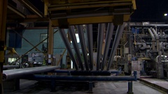 Extrusion billets aluminium casting foundry industry crane lifting heavy metal Stock Footage