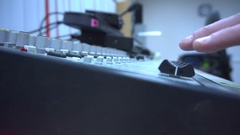 Close up of a finger raising a master audio fader Stock Footage