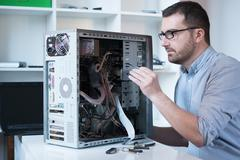 Professional man repairing and assembling a computer Stock Photos